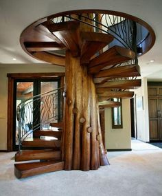 "It's not cordwood, but is certainly is a beautiful center piece for the home. This came from the ""green renaissance"" facebook page. I will post another spiral staircase tomorrow made out of a central log with an ash handle that was boiled and bent to shape. www.cordwoodconstruction.org"