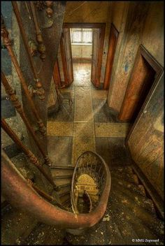 Abandoned - Luxembourg -The majestic old farm of the Heinen family, spiral staircase .