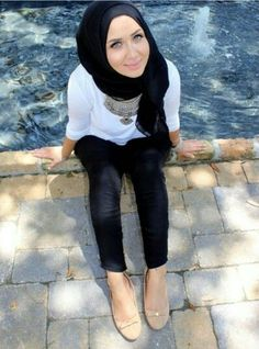 Black pants ans hijab,white top and statement necklace : check out: Esma <3
