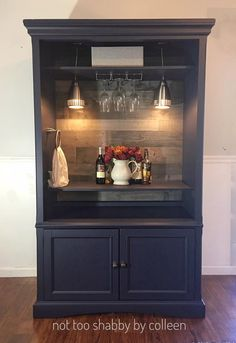 Upcycled / repurposed entertainment armoire converted to a lighted dry bar - by Not Too Shabby by Colleen www.facebook/com/not2shabbyct