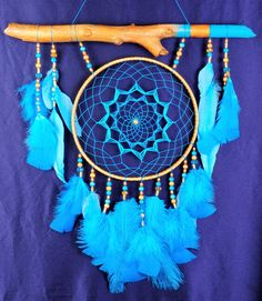 all products in my profile made personally, all the goods are in stock - items can sent in the order day    Blue Dream Catcher Large Dreamcatcher Dream сatcher blue dreamcatchers wall decor handmade Boho turquoise dreamcatcher Christmas gift       This amulet like Dreamcatcher - is not just a decoration of the interior. It is a powerful amulet, which is endowed with many properties:    - Dreamcatcher protects and ensures a healthy sleep to the owner;    Dreams -Lovets helps in practice…