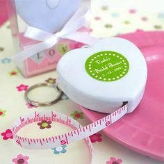These adorable tape measure favors come shaped like a heart or teapot. Can be personalized with a custom label. A popular party favor for bridal showers, baby showers, birthday parties and tea parties.