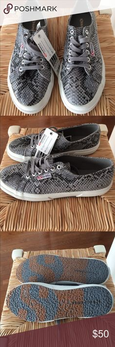 NWT Superga Snake skin leather sneakers NWT Superga Snakeskin leather sneakers grey, white and black with grey laces. Superga the people's shoes of Italy. Super cute and comfy. Smoke and pet free home. Size 9 USA Euro 40. Superga Shoes Sneakers