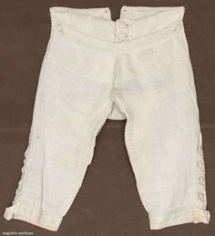 """White home spun raised pin-stripe linen, cut on cross grain, wide W band w/ 3 CF self-covered buttons & pair smaller side buttons to hold up wide fall, 2 pair sewn eyelets at CB W band, 4 buttons & tabs for knee buckles on each leg, gathered baggy seat, W 27+"""", Inseam 17.5"""", excellent. James Kochan - Don Troiani Collections For sale at Augusta Auctions"""