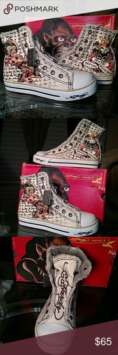 NEW Ed Hardy Graphic Hi Top Sneaker Mulitcolor One of a kind for the tiny fashion forward kid! New, never worn Ed Hardy Hi Top Sneaker with signature tattoo design on both sides and Ed Hardy signature on tongue and up back of shoes! Beige base with black, yellow, orange, red, and brown. Cloth, pull on with rubber toe and sole. Grab these rare shoes today!! Ed Hardy Shoes Sneakers