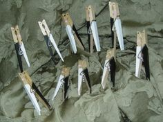 Bride and Groom clothes pins...super cute and functional for the wedding social and oven for the couple.