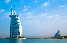 Burj Al Arab  Standing on an artificial island in Dubai, the Burj Al Arab is a striking construction that was designed to resemble the sail of a dhow, a type of Arabian vessel. Rising 321 m (1,053 ft), the 7-star hotel is the second tallest hotel building in the world, surpassed only by the Rose Tower, also in Dubai.