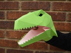 Make your own hand puppets from the jurassic era! These velociraptor puppets are great fun to make and just take some card stock and glue.