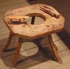A child's six legged stool and toys, 19th century, Finland