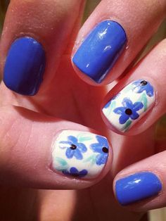 We're obsessed with Jackie's cobalt blue mani! It's perfect for spring, but doesn't feel as overly girly as other floral nail art.   - Seventeen.com