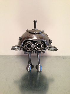 batteries not included robot,spaceship scrap metal art model,steel sculpture
