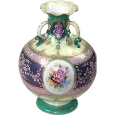 Beautifully hand painted three handled vase with floral design and gold gilt throughout. The moriage is not only applied raised dots, but also applied