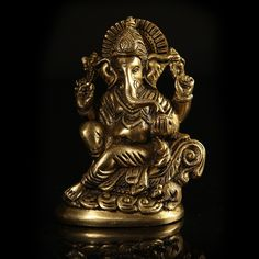 Seen here is Lord Ganesha in his most indentifiable pose, on his throne, and with his chariot mouse next to him. Hand carved and with fine detailing, this figurine is an instant attention grabber while bringing peace and tranquility to your home. http://www.indiancraftsmen.com/home-decor/brass-amp-mosaic/panch-mukhi-ganesh-in-brass
