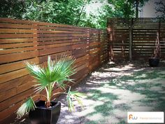 This modern horizontal board fence style was made from imported ironwood lumber (one of the hardest know wood species). #modern #fence #design