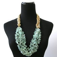 """From the quartet of  pale green chalcedony briolettes to that shining vintage goldtone braided chain (a substantial addition of metallic marvel!) This stunning style, sure to become the charming go-to of you collection, measures 26"""" in overall length.  $308"""