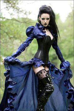 love this dark blue and black goth outfit. and those boots!