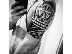 Maori tribal tattoo inspiration on man's shoulder