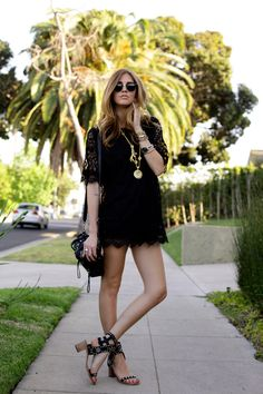Black lace dress + lots of gold jewelry