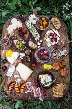 Wow summer guests with a spectacular cheese board (with pickled strawberries and herb-roasted cherry tomatoes).