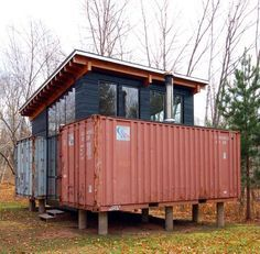 Holyoke Cabin, 2 shipping containers placed on platform, & central living space was built around them. Paul Stankey, with his wife, his brother, and his brother's wife, build cabin on family land in hills N of Twin Cities. bought 2, 20', containers for $800 each In end, cabin home will have kitchen, dining room, living room, wash and clothes area, and 2 queen beds. home will be powered partially by solar array. downspout will be hooked to cistern to collect rainwater.