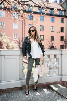 Take a white shirt, add army green tights, a black leather jacket and add a pinch of colour with a pastel bag. Awesome outfit ViaKenza ZouitenJacket: Acne, Shirt: H&M, Tights: Asos, Shoes: Zara, Bag from Zara, Sunglasses: Karen Walker