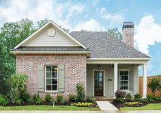 Traditional Exterior of Home with exterior stone floors, exterior brick floors, Pathway, Fence
