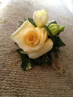 Lemon rose with freesia and beargrass.