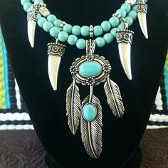 BoHo Native Inspired Howlite & Silvertone Set This is from our new summer FESTIVAL jewelry line it features turquoise dyed howlite silvertone metal and suede necklace. The necklace is 18 inches and while this is not the expensive sets made by the Native Americans it certainly is a piece NOT to be overlooked. Pendant is 3 inches from top of the bail to feather tip. Please feel free to ask any questions prior to purchasing. Jewelry Necklaces