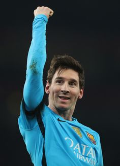Lionel Messi of Barcelona celebrates scoring his second goal during the UEFA Champions League round of 16 first leg match between Arsenal and Barcelona on February 23, 2016 in London, United Kingdom.
