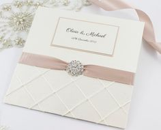 Wedding invitation with ribbon, material and diamanté