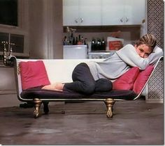 First order in apartment decorating - Breakfast at Tiffany's inspired converted claw foot tub to sofa.