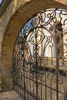 ✥ Stone wall and iron gate