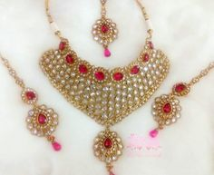 Bridal Necklace Set with Matching Maangtikka & Earrings. A Bridal Necklace Set That Makes you Feel Royal. Wear it as A Statement Piece For Any Special Occasions... #Sparkling #kundan #Kundan #Rubys #ruby #pinkstone #Pinkstones #mangtikka #necklace #desi #desibride #bollywoodjewelry #desijewelry #bollywoodfusion #dubai #mumbaifashion #vamadesigns #singarjewelry #Earrings #gold #desibeautyblog #asiana #asian #dressyourface #instafashion #picoftheday #singarstudio @vivaahvows @vivah.expo