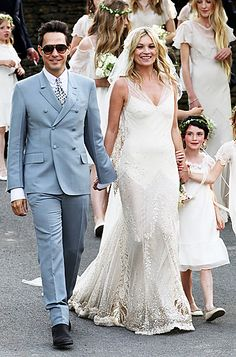 Kate Moss and Jamie Hince on July 11, 2011, in English country wedding featuring gown by John Galliano