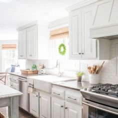 How to Paint Oak Cabinets | Learn about our proven process for how to paint kitchen cabinets and how we hid the grain to achievefactory-like results.