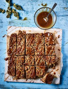 Gluten-free baking needn't be restrictive with our sticky toffee flapjack recipe. Packed with tasty dairy toffees, dates and drizzled with sticky toffee sauce, this is sure to become a family favourite. Tray Bake Recipes, Baking Recipes, Cake Recipes, Dessert Recipes, No Bake Treats, No Bake Desserts, Health Desserts, Sainsburys Recipes, Flapjack Recipe