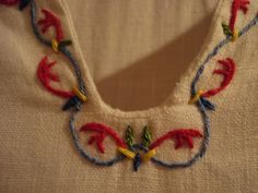 Acanthus embroidery, keyhole neckline (detail) by cripplemusic, via Flickr