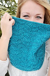 an easily-memorized pattern, a lovely texture that lends itself to either semi-solid or variegated colors, and a pattern that is unisex and perfect for the entire family. The pattern offers two sizes, either an infinity scarf or an oversized cowl, either of which I can't help but envision being bundled up with around my neck when it is chilly and cold! Let it snow!
