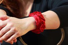 Upcycled silk bangle, red silk sari fabric bracelet, recycled metal bangle. £18.00, via Etsy.