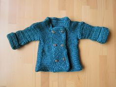 Blue språng baby coat by Sylva-Les on ravelry.com. The posting has pictures and an explanation of the step-by-step process in the creation and construction of the coat.