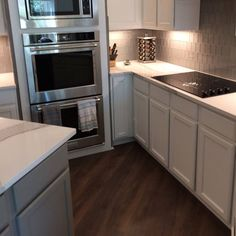 Kitchen remodel in Plano, TX. Brittanicca quartz countertops with glass subway tile.