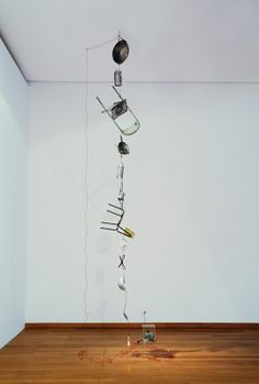 Electrified (variable II) - Mona Hatoum - 2014 - Kitchen utensils, furniture, electric wire, light bulb and variable transformer Dimensions variable