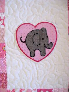 Pretty in Pink Quilt   I have finished my Pretty in Pink Elephant quilt and have uploaded a tutorial for it. It is based on the Little Ele...