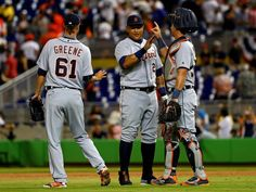 Game 1 - Apr 5 - Detroit 8-7 Miami. B11. Shane Greene, Miguel Cabrera and James McCann celebrate after winning the 2016 Opening Day game against the Miami Marlins at Marlins Park in Miami, Florida.  [Mike Ehrmann, Getty Images]