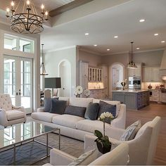 When homeowners invite guests and company into their home typically the first thing that visitors see is the living room, or family room, of the house. Home Living Room, Living Room Decor, Living Area, Living Room Kitchen, Chandelier For Living Room, Open Plan Kitchen Dining Living, Living Spaces Furniture, Kitchen Office, Sweet Home