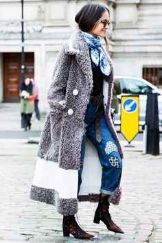 A grey nubby coat is worn with embroidered denim, a printed scarf, and lace-up statement booties