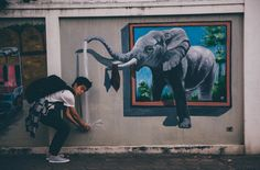 Along the lanes and alleyways of Chiang Mai, you'll find wall drawings and murals that can form great backdrops for photos. In this photo is a painting of an elephant spraying water, celebrating the importance of this animal to Thai culture and society. Northern Thailand, Wall Drawing, Alleyway, Hotels Near, Chiang Mai, Murals, Backdrops, Elephant, Culture