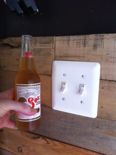 Here is the finished outlet work on the wood pallet wall... Next to a beer.    www.ifinishedmybasement.com