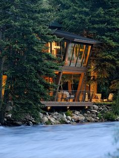 Aspen River House by architects David Johnston and John Hufker of David Johnston Architects  more: http://www.aspensojourner.com/Aspen-Sojourner/Mountain-Homestyle/Midsummer-2008/A-River-Almost-Runs-Through-It/
