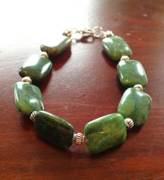 Marbled emerald green stone and silver metal by TheFloralFern